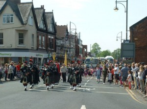 The procession lead by Northenden Pipe Band